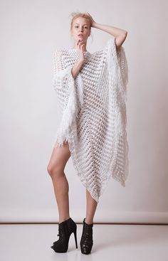 This crochet summer long poncho, dress, with fringes, shines under the sun and it is made from a glamorous white fashion yarn, cotton and premium acrylic mix.  One size, it is a very special garment for very special ladies. Sexy, elegant, boho and OOAK! This is not the everyday casual cover up, this is for the days when you love to impress and be remembered! An awesome fashion garment youll love wearing  It is ready to ship!  Be sure to check all the photos to see it in different angles…
