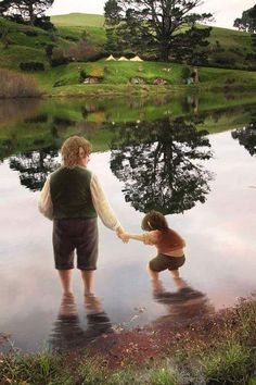 I'd like to think this is Bilbo with young Frodo! (Even though Frodo was probably around age 20 or so when Bilbo adopted him.