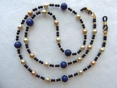 This handcrafted eyewear chain is decorated with Lapis Lazuli and pearls ~ Visit www.arepaki.etsy.com