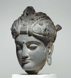 A Gray Schist Head of a Bodhisattva* GANDHARA. Location: Gandhara, ancient name of a region in northwest Pakistan bounded on the west by the Hindu Kush mountain range and to the north by the foothills of the Himalayas. Sculpture Head, Buddha Sculpture, Stone Sculpture, Buddha Kunst, Buddha Art, Ancient Names, Ancient Artifacts, Art Asiatique, Religion