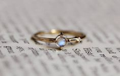 Hey, I found this really awesome Etsy listing at https://www.etsy.com/listing/594357023/14k-moonstone-side-diamond-ring