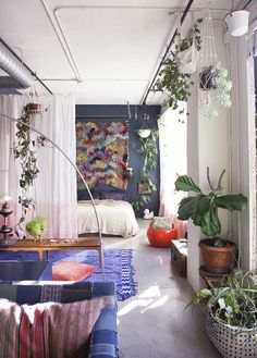 Mix Home & Garden Ideas. Bright Blue Hues & Green Plants Are Complementary in a Small Space.