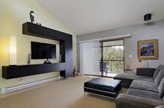 Contemporary Living Room with High ceiling, Built-in bookshelf, flush light, Ikea Besta Shelf Unit With Door, Laminate floors