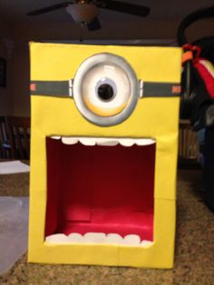 Shoebox minion. Good ideas is to make out of cardboard box and can be used as party picture frame.