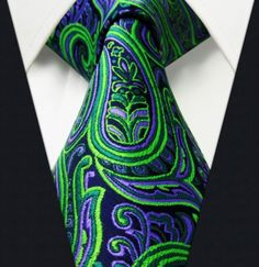 """Product number: PA-5781 Length: 57"""" Width: 3.5"""" Material: 100% Silk Care: Dry Clean Only Label: GENTLEMAN JOE This stunning, green and purple paisley tie is gorgeous! It can be worn with almost any co"""