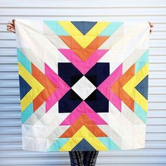 "Who needs a fun weekend project? This quilt can be made with a FQ bundle of the 11 Add It Up colors! Let's call this a #CSinstapattern - to make this quilt, follow the instructions below! || Supplies: FQ bundle of Add It Up || Cut: 5"" squares in these quantities: Black 2, Navy 8, White 10, Pink 12, Orange 12, Yellow 12, Teal 8, Lt Gray 12, Dk Gray 4, Neon Orange Plus 10, Green Plus 10. Cut all squares diagonally into triangles. 