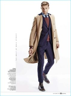 Channeling Wall Street style, Mikus Lasmanis dons a navy pinstripe suit from Hilfiger Edition. The model also wears a Hackett London coat, Prada shoes, and a Piaget Polo S watch.