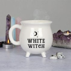 This brilliant white witch mug is designed to look like a cauldron and features the words 'White Witch'. The mug comes in a matching cardboard box. Suitable for microwave or dishwasher use. White Coffee Mugs, Coffee Cups, Tea Cups, Witches Cauldron, Witches Brew, Bob Ross, Pause Café, The Black Cauldron, White Witch