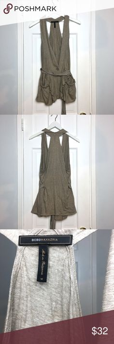 BCBG Max Azria tan jersey tank top sz M BCBG Max Azria tan jersey tank top sz M Made in: Philippines Size: M Fit: loose Shoulders: n/a Chest: 36 Waist: 32 Length: 30 Sleeve: n/a Materials: cotton, modal Color: tan Condition: excellent, like new #coxycloset #BCBG #maxazria #top #tanktop #jersey #casual #daywear #light #spring #summer BCBGMaxAzria Tops Tank Tops