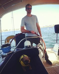 Here's a picture of Alexander Skarsgard sailing a boat with a dog in a life jacket. The end.
