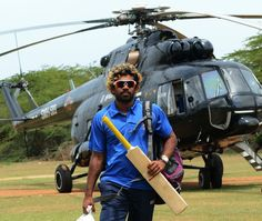 Lasith Malinga arrived in Hambantota in an air force helicopter.   (Image Courtesy: AFP)