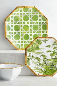 Go retro with Pier 1's classic '60s-style Chinoiserie Lattice Green Melamine Dinnerware. The dinner plate is bright green on white, while the salad plate depicts a traditional Chinese scene. The bowl is white with a lattice-print bottom. All feature decorative bamboo-look rims and are dishwasher-safe.