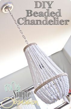 DIY Beaded Chandelier, there 16 others to choose from. Take an plain or thrifted chandelier, and upcycle it into a fabulous fixture for your home. Plus, 16 DIY Beaded Chandelier tutorials. Diy Décoration, Diy Crafts, Bead Crafts, Home Projects, Craft Projects, Luminaria Diy, Wood Bead Chandelier, Chandelier Lamps, Round Chandelier