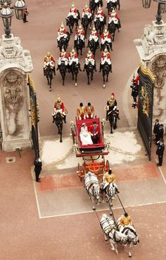 TRH Prince William, Duke of Cambridge and Catherine, Duchess of Cambridge approach by carriage procession, Buckingham Palace following their...