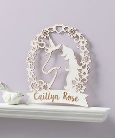 Laser-cut from birch wood and painted with a slightly distressed decorative finish, this plaque makes a great personalized addition to a little one's room. Shipping note: This item will be personalized just for you. Allow extra time for your special find to ship.