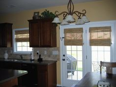 Love the look of the bamboo roman shades for french doors and kitchen window. Ready to change my window treatments and I think this is what I want.