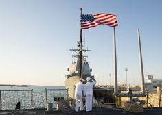 ROTA, Spain (May 21, 2016) Fire Controlman 3rd Class Chase Gibb, from Omaha, Nebraska, left, and Information Systems Technician Seaman, Nathanial Casteel, from West Liberty, Kentucky, hoist and render honors to the National Ensign aboard USS Porter (DDG 78) during morning colors as the ship is moored in Rota, Spain for a scheduled port visit May 21, 2016. Porter, an Arleigh Burke-class guided-missile destroyer, forward-deployed to Rota, Spain, is conducting a routine patrol in the U.S. 6th…