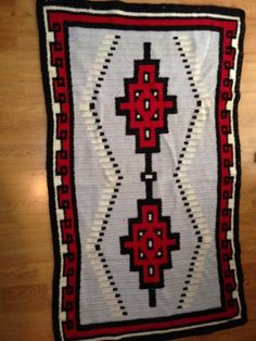 Ravelry: Ganado Red Feather Coverlet pattern by Sharon L. Double Crochet, Hand Crochet, Legal Size Paper, Simple Borders, Navajo Rugs, Red Feather, Ethnic Patterns, Afghan Blanket, Red Background