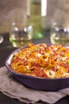 This rigatoni with ricotta pasta bake is sure to become a family favorite. It includes a simple tomato sauce with cheesy pasta which is baked in the oven to bubbling perfection.