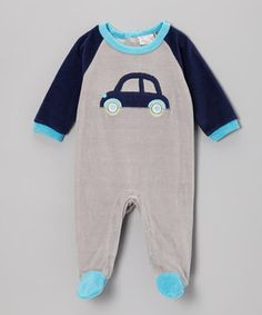 This appliquéd footie features snaps in back and between the legs for quick changes. Made from soft velour, it's cozy on everything from tiny toes to ticklish tummies.