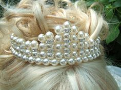 measures 1.5 inch or 4 cm at its highest peak and was created using glass pearls and crystal rhinestone spacers all attached to a silver toned tiara band with non tarnish beading wire.
