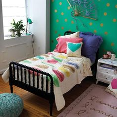 Fun girl's bedroom!  Love the teal wall with gold dots and the Jenny Lind Kids Bed