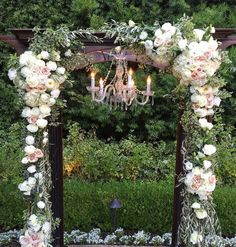 Wedding Ceremony Flowers. Wedding arch with chandelier. Blush and white wedding at Franciscan Gardens. Roses, dahlias, olive, hydrangea. Florals by Jenny