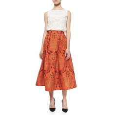evaChic | This Alice + Olivia Luisa Floral Jacquard Box Pleat Midi Skirt is a modern take on timeless separate. Wear it as a statement-making skirt or as a bright eveningwear piece to accentuate an otherwise monochrome look.  http://www.evachic.com/product/alice-olivia-luisa-floral-jacquard-box-pleat-midi-skirt/