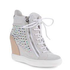 High-top sneakers with a concealed platform, two zippers and rhinestones.