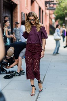 Olivia Palermo in a grape top and skirt, paired with black sandals.