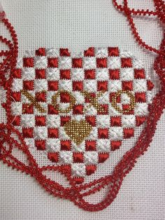stephs stitching; love this needlepoint heart!