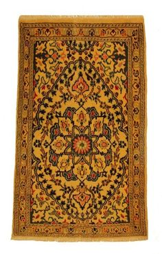 This small traditional Persian rug is from the Nain region. The rug is unique with a foundation pile of wool and is handmade. It has strong gold colours, with a tasseled edge. To avoid disappointment order now, each rug is unique, so there is only one available.