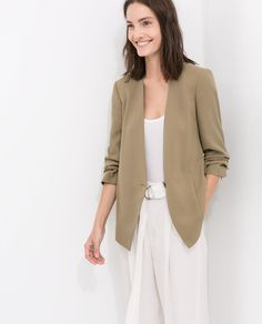 all white and light brown blazer