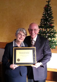 Classic Cinemas owners Willis and Shirley Johnson receiving the DuPage Co Historical Award on 11/17/2012