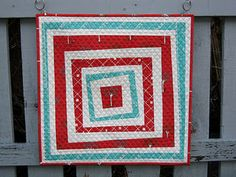 Even though I like things symmetrical, I really like the uneven strips in this quilt.