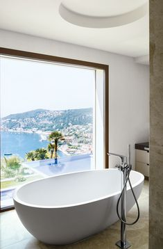 An agape soaking tub overlooks the Bay of Villefranche on the French Riviera.