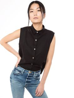 Black sleeveless summer shirt with white buttons. Zady | The Top Ten Modern + Ethical Clothing Brands. sustainable style | sustainable fashion