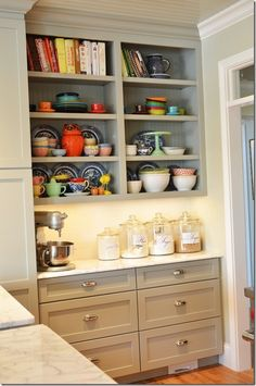 I wonder if could do this in my kitchen between the pantry and the sunroom....hmmmm...more storage and counterspace!!