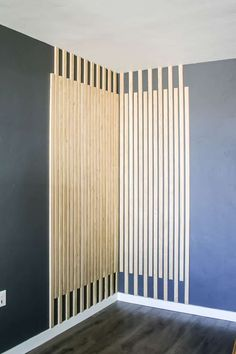 When I was planning our modern bohemian living room design, I knew I needed to figure out how to incorporate this awesome vertical wood slat wall into our room.