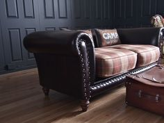 re-upholstered sofa in Tartan (plaid) and leather. This is exactly what I want to do to my two leather armchairs.