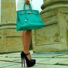 Perfection. White dress Turquoise bag Black heels.....