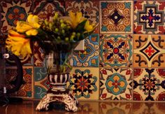 Santa Barbara tiles inspired the kitchen colors, which include turquoise and red on cabinets and warm gold on walls. Photo: KIN MAN HUI, SAN ANTONIO EXPRESS-NEWS / San Antonio Express-News