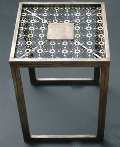 """Drinks table handcrafted in steel and bronze 