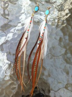 Feather earrings w/ rhinestones.