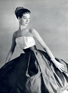 Evening dress by Maggy Rouff, jewellery by Roger Scemama, 1956.