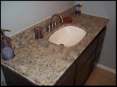Giani Granite Top After. This is the basic contractors sink you get when you purchase a home, but now it has Giani Granite Paint!!!