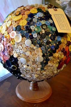 Button-covered globe at Nest Vintage Modern