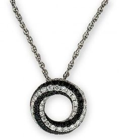 """This """"twirling eternity"""" pendant contains a total of 80 black and white diamonds."""