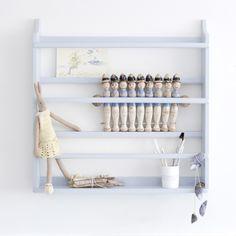Light blue plate shelf, hipvilla.com.  Great storage in the children's room!