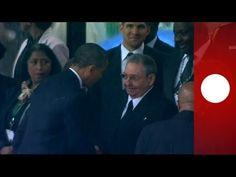 E' l'agenzia Reuters a diffondere lo scatto che passerà alla storia: in occasione della Commemorazione di Nelson Mandela allo stadio  http://tuttacronaca.wordpress.com/2013/12/10/usa-cuba-mandela-regala-il-disgelo/..